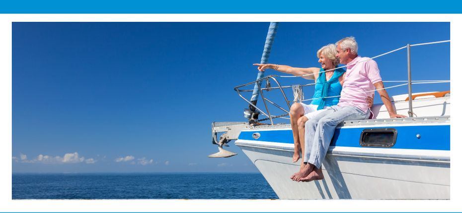 Suchan McQuaid Wealth Management | Elderly couple sitting on the side of a boat